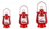 Evolution concept.Red kerosene lamps isolated on white