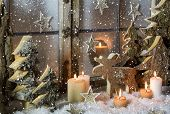 stock photo of xmas tree  - Natural christmas window decoration with handmade reindeer and trees of wood.