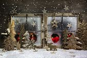 Mood And Atmosphere: Christmas Window Decoration In Red With Wood.