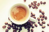 Espresso Coffee Cup With Coffee Beans, Vintage Toned Photo