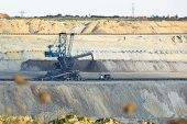stock photo of dredge  - a huge working dredge in a mine - JPG