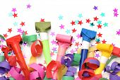 Confetti and whistles on white background
