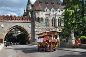 Budapest, Hungary - Circa July 2014 : Bierbike With Tourists Is Entering The Gate Vajdahunyad Castle