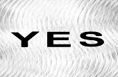 The word Yes on crumpled sheet of paper