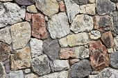stock photo of stonewalled  - Stonewall of rough stones  - JPG