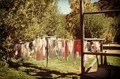 A laundry line in a rural setting with a retro instagram look with vignette.