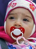 Closeup Face Of Small Child With Pacifier