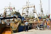 AGADIR, MAROCCO - AUGUST 27: View of fishing boats in Essaouira port on 27 August 2014 in Agadir, Ma