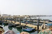 AGADIR, MAROCCO - AUGUST 27: View of fishing boats in Essaouira port on 27 August 2014 in Agadir, Marocco. Morocco is one of the largest producers of sardines in the world.