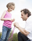 Father and daughter together with skipping rope