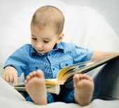 little boy reading a book
