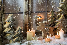picture of xmas star  - Natural christmas window decoration with handmade reindeer and trees of wood. ** Note: Shallow depth of field - JPG