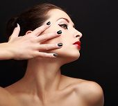 Sexy Makeup Woman With Black Nails On Face