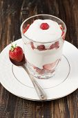 Strawberries With Whipped Cream In A Glass.