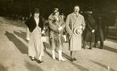 GERMANY, CIRCA THIRTIES: Vintage photo of elegant man and two women in coats and hats walking