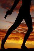 Silhouette Of Woman Legs Hold Gun Down Walk
