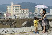 People enjoy the view to downtown Macau, China.