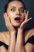 portrait of surprised beautiful girl in open-mouthed