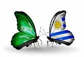 Two Butterflies With Flags On Wings As Symbol Of Relations Saudi Arabia And Uruguay