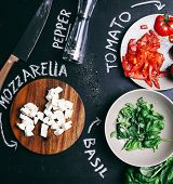 Food, cooking. Salad with mozzarella on the table
