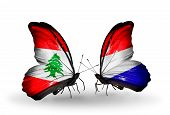 stock photo of holland flag  - Two butterflies with flags on wings as symbol of relations Lebanon and Holland - JPG