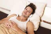 Smart Guy Lies In Bed And Listens To Music