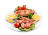Tasty baked fish on plate isolated on white