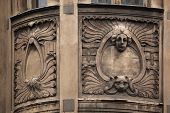 Floral ornamental decoration and mascaron on the the Art Nouveau building in Prague, Czech Republic.