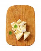 foto of penicillium  - Pieces of French white rind cheese - JPG