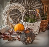 Heather In A White Basket Next To A Candle