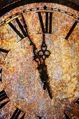 Rusty, rough clock face showing midnight