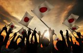picture of japanese flag  - Group of People Waving Japanese Flags in Back Lit - JPG