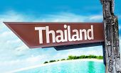 Thailand wooden sign with a beach on background