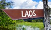 Laos wooden sign with a forest background