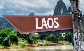 Laos wooden sign with exotic background