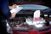 Mechanic working in auto repair garage. Car maintenance