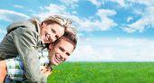 Happy smiling loving couple enjoying outdoors. Summer vacation