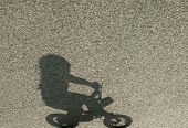 Shadow of a child on a bicycle
