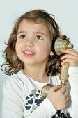 Young girl on the retro telephone