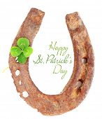 Old horse shoe with clover leaf isolated on white, Happy St.Patrick's Day greeting card
