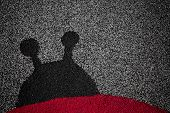 stock photo of linoleum  - The silhouette of a ladybug on linoleum - JPG