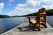Wood chair on lake deck in summer