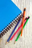 Notebook and colorful pencils