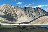 pic of jammu kashmir  - Mountains and Pangong tso (Lake). It is huge lake in Ladakh altitude 4350 m (14270 ft). It is 134 km (83 mi) long and extends from India to Tibet. Leh Ladakh Jammu and Kashmir India
