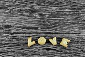 Love word cookie on old wooden background