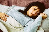 Portrait Of Sad Woman Lying In Bed After Breaking Up With Boyfriend