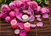 Pink Candles ,bowl and lying down rose, Petals on mat