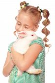 Little girl with a rabbit in her hands