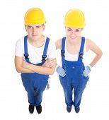 Team Work Concept - Handsome Man And Beautiful Woman In Blue Builder's Uniform Isolated On White