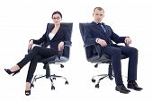 Young Handsome Man And Beautiful Woman In Business Suits Sitting On Office Chair Isolated On White